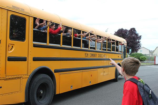 School bus with waving students
