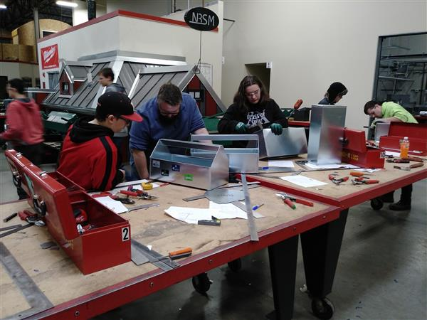 Students work on making their own toolboxes